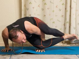 Eight angle pose or astavakrasana