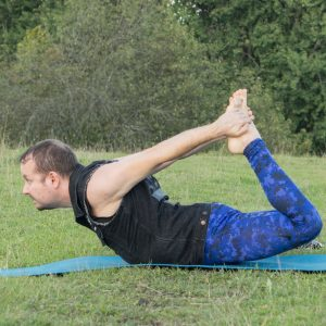 Bow pose or dhanurasana in early autumn