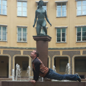 Upwardfacing dog in September 3rd 2017. I bring an upward facing dog on the fountain in the center in  Brantingtorget,  Gamla Stan,  Stockholm.