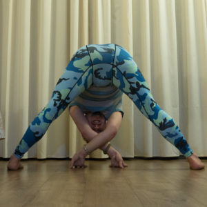 Wide legged forward fold in February 24th 2018. I bring a  Straddle Fold or  Prasarita Padottanasana here. I learned on my  Ashtanga classes the importance of breathing into  Forwardfolds (and a lot other stuff), and see every breath as an opportunity to