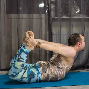 Lukas Mattsson doing Dhanurasana or Bow Pose.
