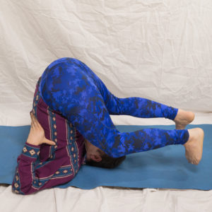 Ear Pressure Pose in April 28th 2018. Nabhi drishti is focusing on the bellybutton.  Karnapidasana is the third pose in a sequence taught in  Ashtanga Yoga, which starts with shoulder stand an