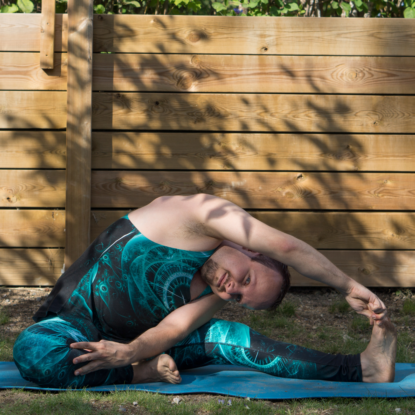 Revolved Head to Knee Pose in June 23rd 2018. I entered this from  Janu Sirsasana, the forwardfold with head to knee, and reached for the other knee. I have hard to smile in this one, like in