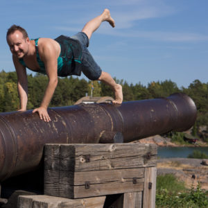 Plank pose in July 13th 2018. Jumping in here :) I bring a  Plank or  Ado Mukha Dandasana with one leg up on a cannon in  Bomarsund fortress,  Aland Islands. Everyone needs a few weeks of vaca