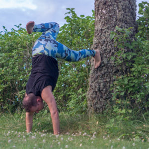 Handstand in July 4th 2018. This one was really though, my attempts in unsupported handstands yielded something like a crude split. So I decided to step back and do it with tree support.