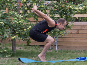Chair Pose in August 1st 2018. I bring a  Utkatasana  Chair Pose variation with  Tiptoe Balance, forward fold and arms extended backwards.