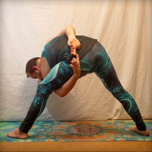 Bound triangle in February 5th 2019. I bring Baddha Trikonasana or Bound triangle from front and rear view. It's one of few poses I can bind in.