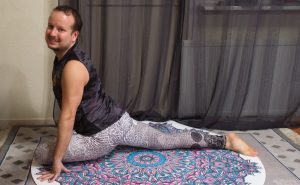 Pigeon pose on round yoga mat, an excellent hip opener