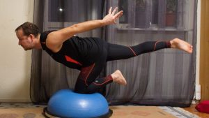 Kneeling balance on bosu ball