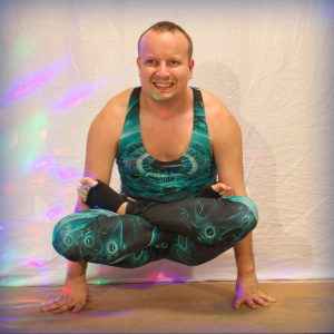 Utpluthih in May 18th 2019. I chose Scales pose or Utpluthih and eight angle or Astavakrasana as both are good for smiling. Utpluthih is also known as Tolasana and was the first armbalance I g