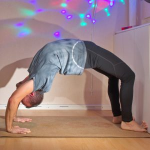 Wheel pose with using wall for friction assist