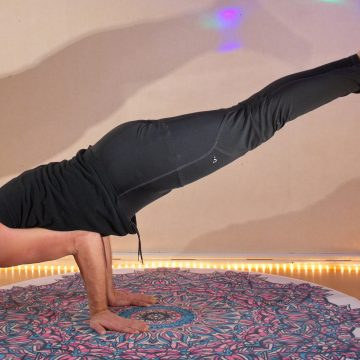 Lukas Mattsson doing Mayurasana, an arm balance