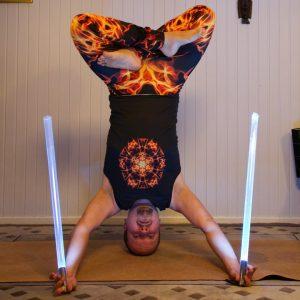 Mukta Hasta Sirsasana B in February 7th 2020. It ain't Starwars yoga without light sabers :)