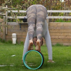 Downward Facing Dog in May 12th 2020. Happy humpday! I'm catching up with a shortened Downward Facing Dog variation with feet on wheel.