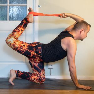 Tiger pose in July 23rd 2020. Tiger pose or Eka hasta vyaghrasana can be either grabbing opposite foot or same foot. Opposite is tougher for me, and it's my choice today. I bring both sides.