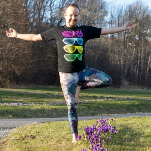 Tree pose in April 13th 2021. Doing a Vrksasana or Treepose accompanied by crocuses in the sunset